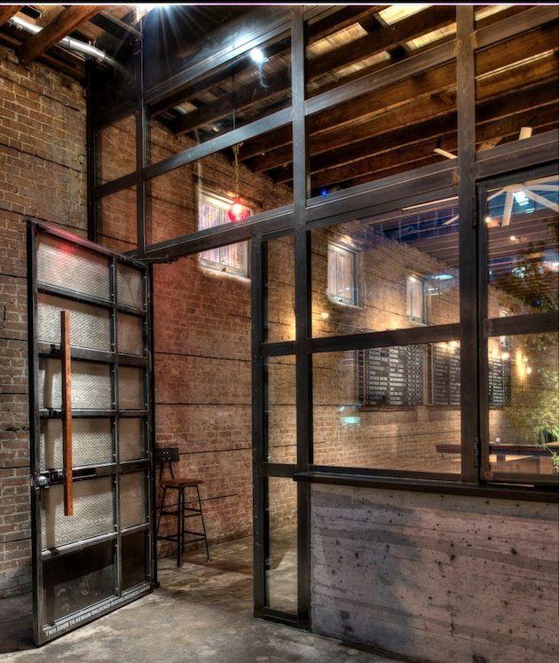 Industrial houston bar in a 1900s building beerpub for Garage paris bar