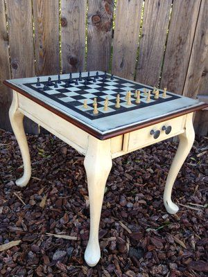 Checker Board Table... Would be great in basement.  Want lots of fun games such as darts, pool table... Fun to make this and use bottle caps as the game pieces.