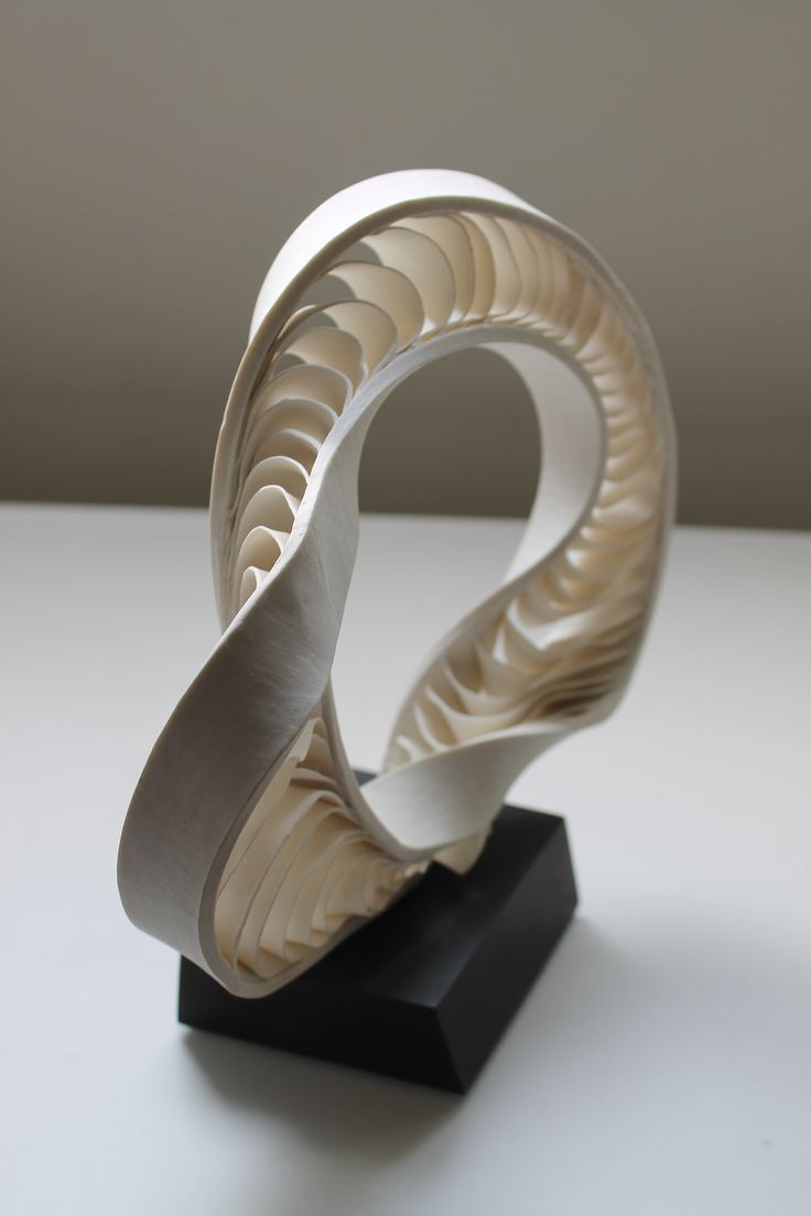 Porcelain Mobius sculpture mounted onto African ebony