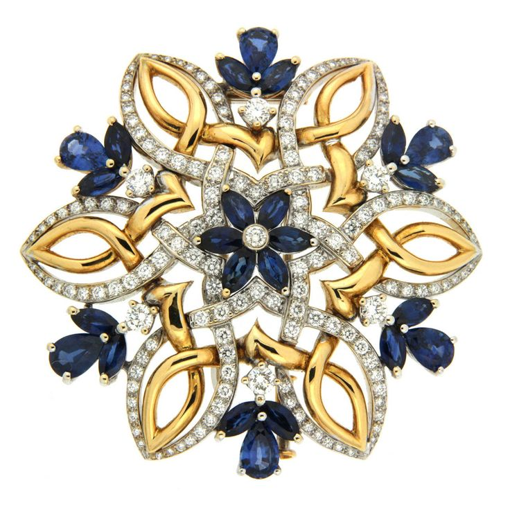 Valentin Magro.This brooch is made in 18kt yellow and white gold, it features 2.96 carat total weight of round brilliant diamonds with VVS clarity and D.E.F color, and a total of twenty-four, marquise and pear shape blue SAPPHIRES. Circa 2004s