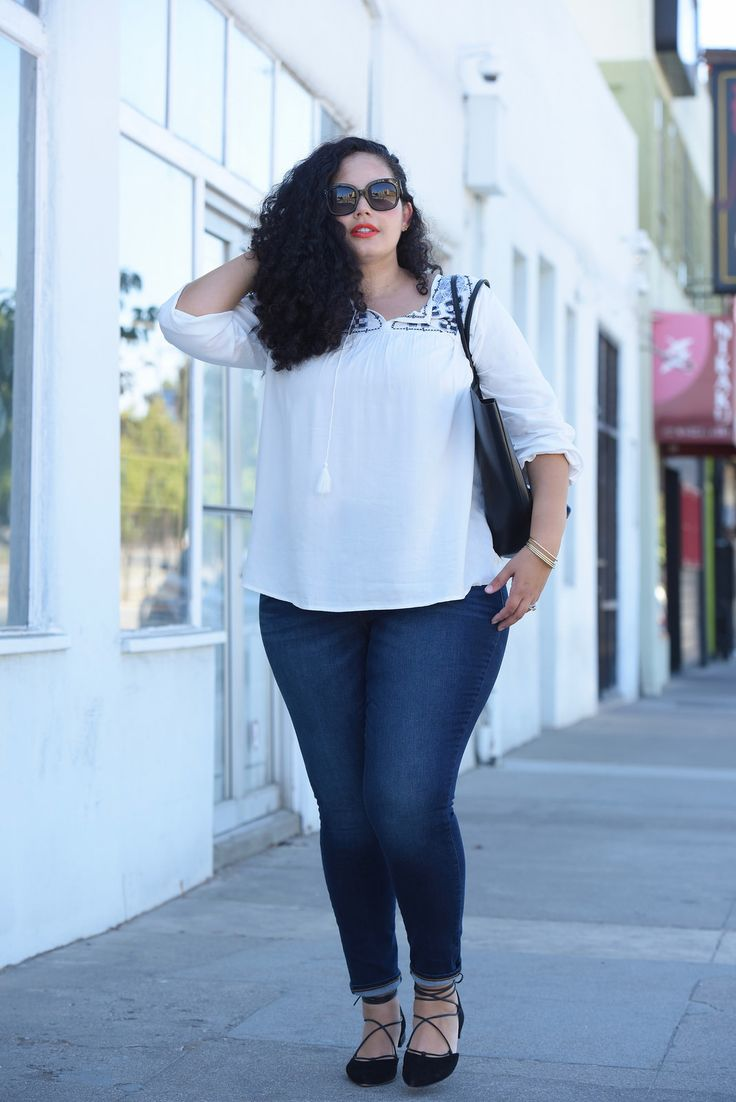 Tanesha Awasthi, also known as Girl with Curves, wearing dark wash plus size…