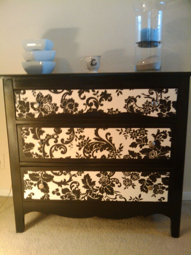 DIY dresser... Found this on the side of the road added some paint and wallpaper.. Love it