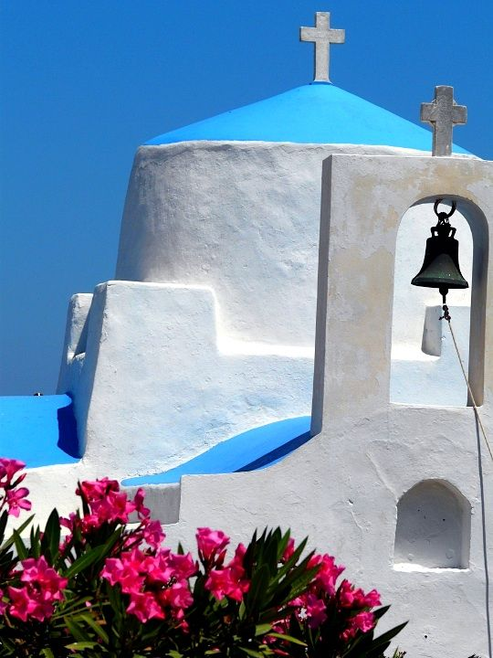 Blue dome, white bell tower and pink oleander in Serifos