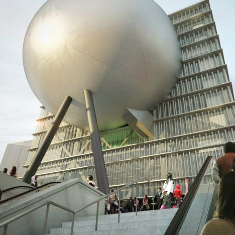 Certainly unexpected!  I like the 'wrecking ball' idea and using the space to create a spherical stage is pretty swell.