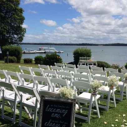 Sarah's #gorgeous #outdoor #wedding #ceremony @Rafferty'sresort #white #folding #chairs #blackboard #rosepetals