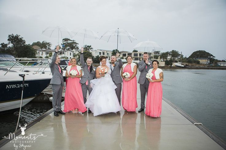 Sydney Wedding Photography.  Bridal party. Rainy. Pink bridesmaid dresses. Pink and grey suits. Umbrellas. www.momentsphotography.com.au