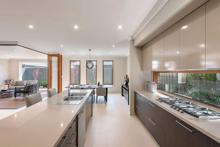 The stunning kitchen overlooks an amazing indoor and outdoor dining area #weeksbuildinggroup #newhome #homedesign