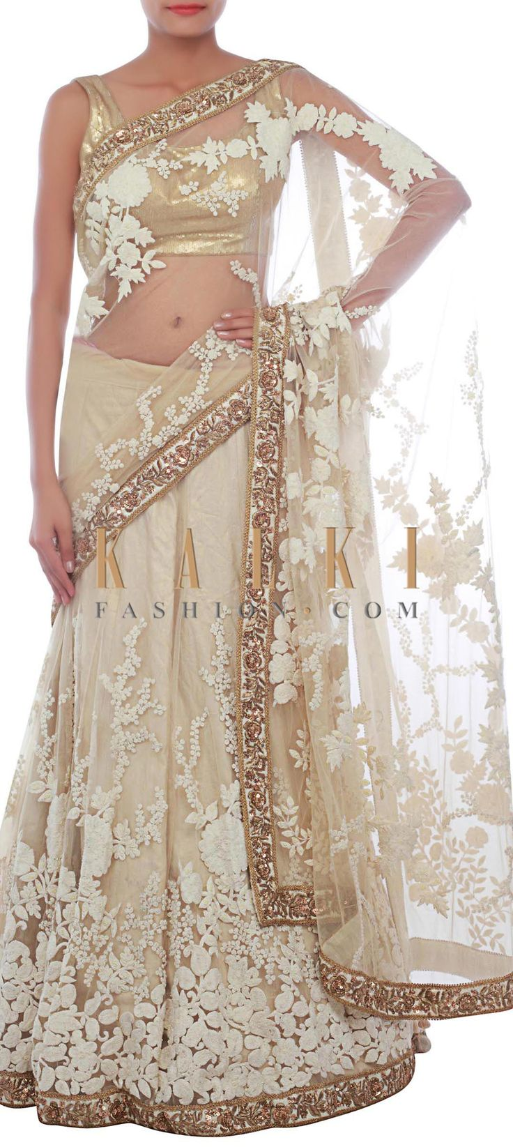 Buy Online from the link below. We ship worldwide (Free Shipping over US$100) http://www.kalkifashion.com/beige-lehenga-saree-embellished-in-pearl-and-thread-embroidery-only-on-kalki.html