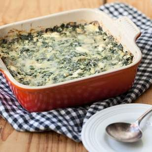 A riff on traditional spinach artichoke dip, this creamy, cheesy dip recipe is made healthier by replacing some of the cream cheese with yogurt.