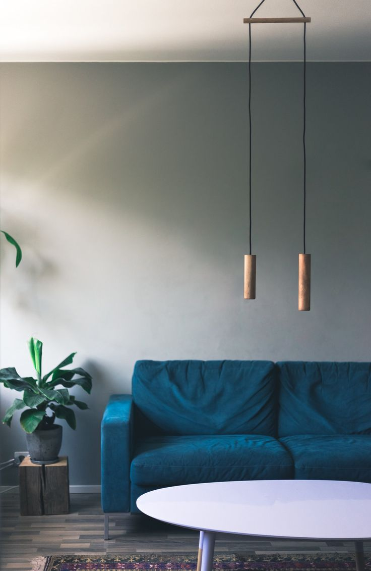 Wooden pendant lamps on top of living room table