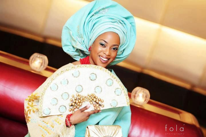 A happy bride in her traditional costume