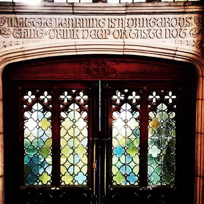 """A knowledgable campus door, reading """"A little learning is a dangerous thing. Drink deep or taste not."""""""