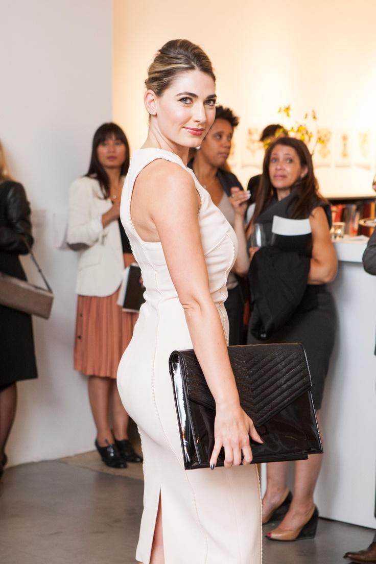 Ellian Raffoul holds Jill Milan's Newbury Street portfolio.