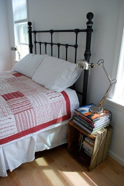 Susan & Ryan's Less-Is-More Farmhouse - books in and on crate with reading light bedside