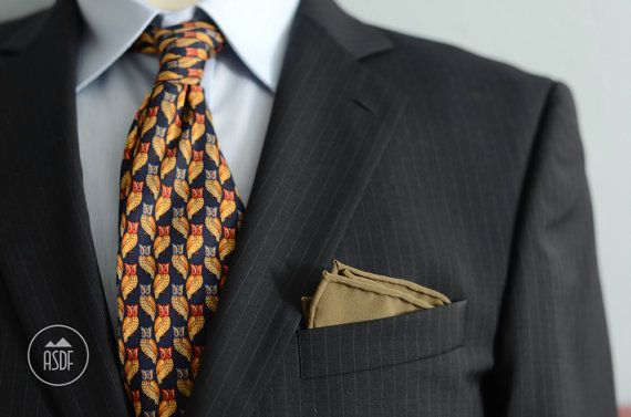 Size of the pocket square is approx 15-16 (~40cm). Size depends on the thickness of the material to be able to safely lay in the bottom of the pocket.