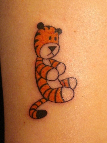I would never get a cartoon character tat....but had to pin this Hobbes one because its too stinkin' cute!
