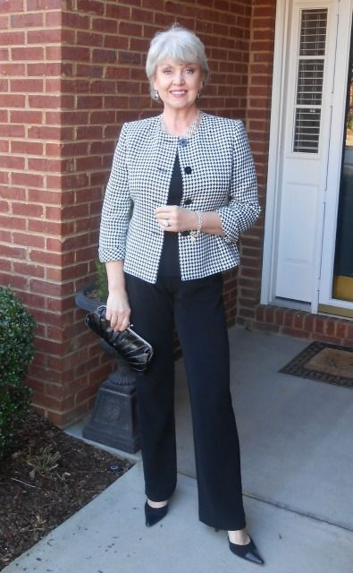 Susan layers a graphic black and white jacket over her monochromatic top and pants. This crisp look works for daytime or evening.