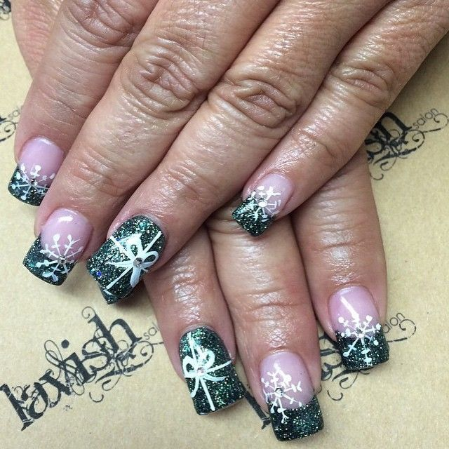 Love these Christmas nails done by @khttnnailsquad using Tammy Taylor Nails Dazzle Rocks Pine Needle, True Pink, Assorted Rhinestones and White Gel Paint!!!