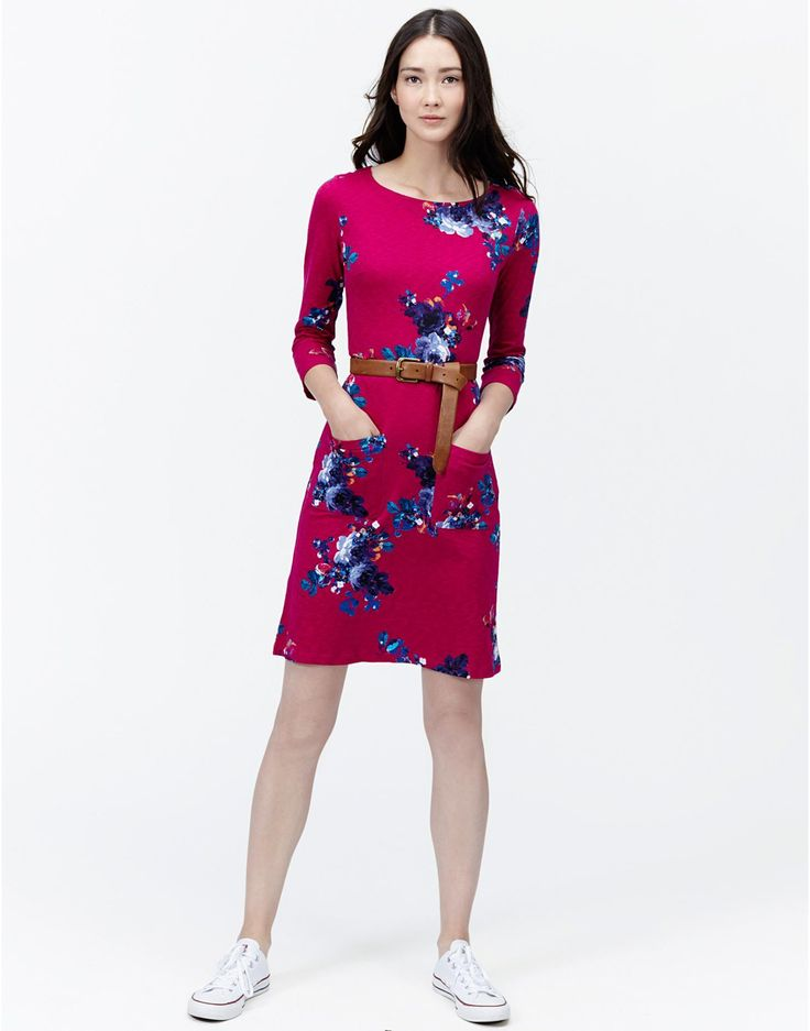Joules Womens Casual Jersey Dress, Ruby Pink Floral.                     Every wardrobe needs a casual, easy-to-wear dress that's perfect for wearing time and time again. We've crafted this one from cotton slub for comfort but the in-house hand-painted print makes it feel really rather special.