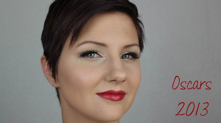 Inspired by Jessica Chastain, this look has full lashes, red lips, and a glittery champagne lid.