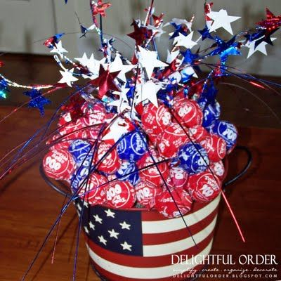 """WOW! This blog entry has some fabulous ideas for the 4th of July...I love this lollipop idea, but she also another photo of a """"firecracker"""" candy display, napkin rings, water bottle labels and so much more!"""