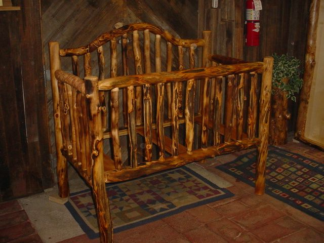DIY Crib. This has smoother smaller spindles. I like the small pillars/spindles. I would like lighter wood though.
