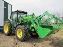 John Deere 6420 Tractor with John Deere 673 Self leveling Loader and Grapple | Proxibid Auctions