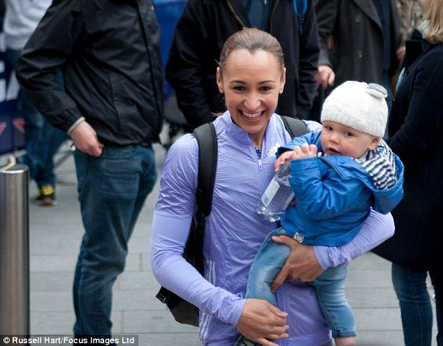Proud mum: Jessica Ennis-Hill, 29, allowed the public to see her little boy Reggie for the first time at the Great City Games, where she casually strolled along while cradling him in her arms on Saturday