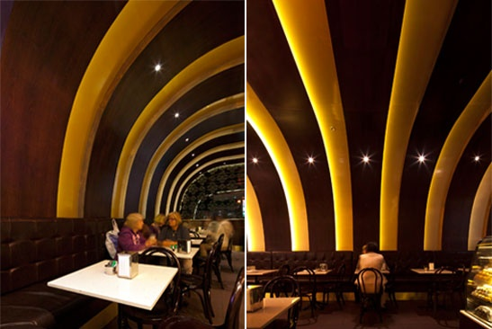 The wooden veneer and gold curved ribbed ceiling gives the space a sense of grandeur and indulugence in Sergio's Cake Shop, Blacktown, NSW, Australia. http://www.forwardthinkingdesign.com.au/sergios-cafe/