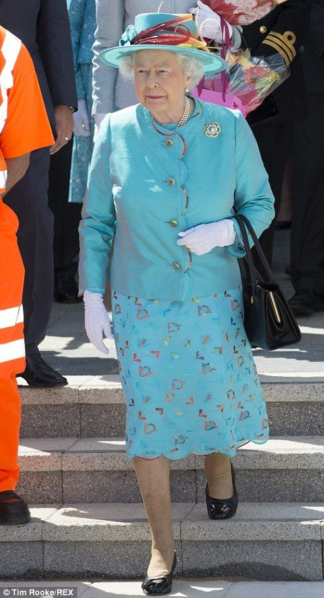 The Queen wore a summery turquoise ensemble for the official opening of the refurbished Reading Railway Station. July 17, 2014