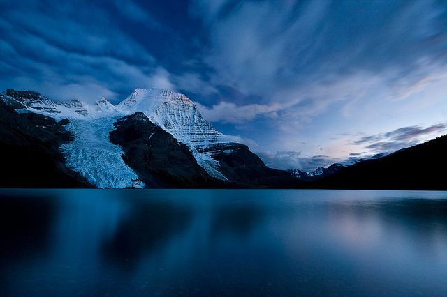 """Making it to Berg Lake (especially at sunrise, or twilight, when this shot was taken) is a must-do.     """"We weren't lucky enough to get a sunrise at both Assiniboine and Mount Robson, but the Emperor Face (north face of Robson) did reveal itself after sunset.    Berg Lake, Mount Robson Provincial Park, B.C., Canada."""" #explorebc    Photo by,"""