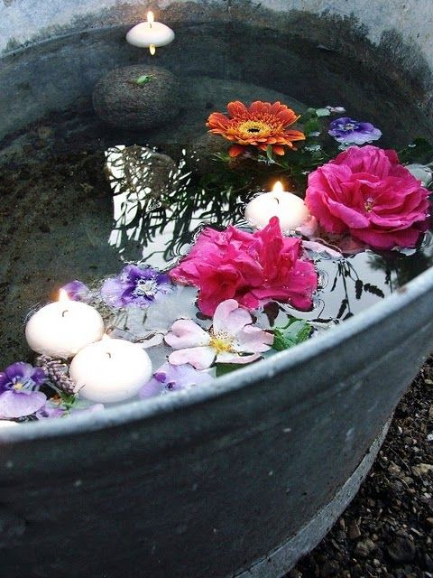 So nice and simple! Old zinc tub filled with water, some rocks, fresh cut flowers and floating candles