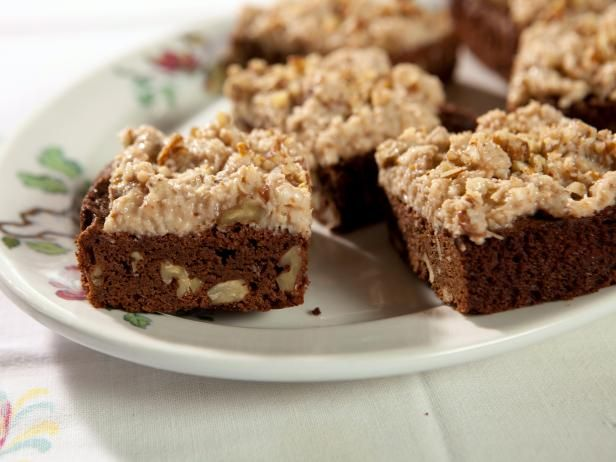 Trisha Yearwood cooks up these nostalgic Brownies with Coconut Frosting.