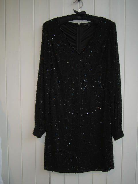 Beautiful party dress! #littleblackdress #christmasparty #blackbeadeddress #wowdress #aidanmattox #deuxiemedressagency #londondressagency