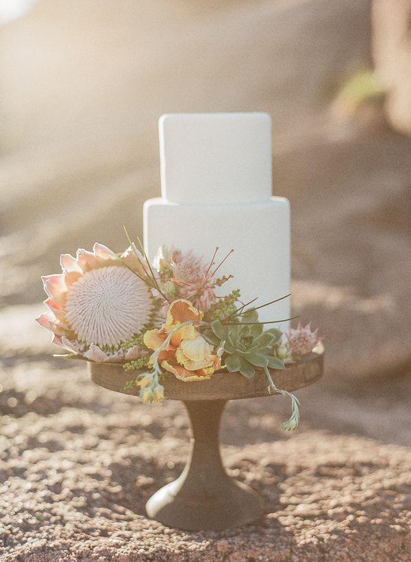 cake with protea decor - photo by Bella Reese Photography http://ruffledblog.com/graceful-desert-wedding-at-enchanted-rock #weddingcake #cakes