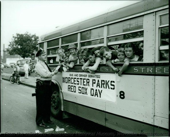 Red Sox fans on bus trip sponsored by Worcester Parks, August 29, 30, 1950, Worcester Massachusetts. Photograph by George Cocaine.  Want a copy of this photo?  >Visit our rights and reproductions page for more information.    #Worcester #WorcesterHistory #WorcesterMA #Children #SchoolBus #RedSox #Police #Cop #1950s