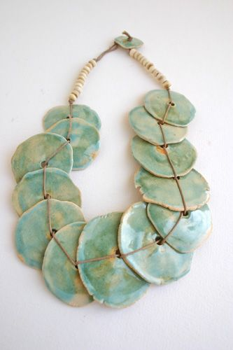 Handcrafted Ceramic Art Jewelry by Rosa Silverman.. mayby make a variation with my big shells!!