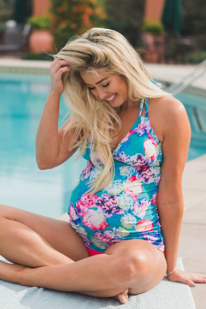Splash into style with this amazing floral print maternity tankini top. This tankini top features a triangle, halter top and ruched sided that will flatter your growing baby belly. Pair with a solid maternity bikini bottom, a flowy skirt, and strappy sandals for a complete look.