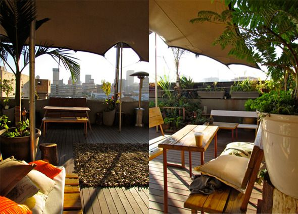 Enjoy a sundowner on the rooftop venue, The Living Room, in Maboneng with a stunning view of the Joburg skyline.
