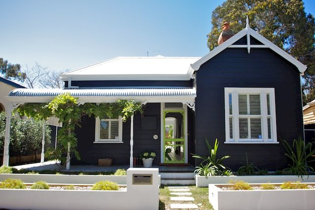 The contrasting color scheme is beautiful, love the gable front and bullnose verandah!