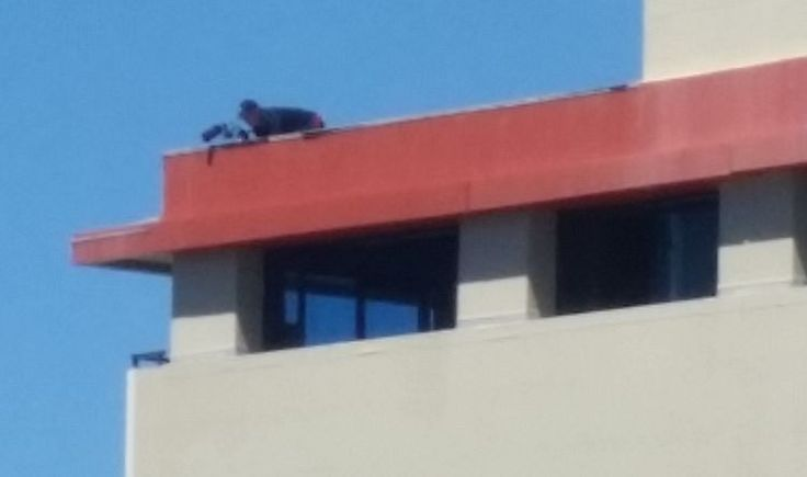 I hope not a sniper on roof of 49 Boulcott St, Wellington. More probably a photographer; but what was he photographing at that height?