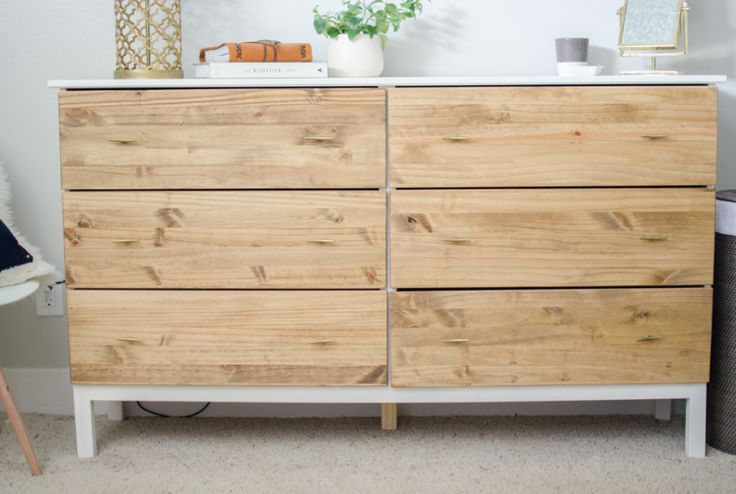Remember we told you of IKEA Tarva dresser hacks? Here's one more idea that wasn't on the list. You'll need Ikea Tarva dresser, a hammer + screwdriver, wood stain, paint, protective coating, a paintbrush, floor tarp, extra fine sandpaper, hardware for knobs. Set the drawers aside for now and get started painting the frame. Lay...