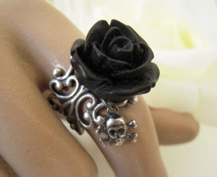 Goth Black Rose Skull Ring- Antique Silver Adjustable Ring- Skull Candy Black. $15.00, via Etsy.