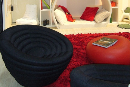 We couldn't keep the kids away from this exhibition play zone with comfy swivel chairs, felt petal rug and LED lit reading nook.  http://www.kidsindesignedspaces.com.au/exhibitions