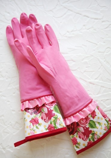 Pink Spring Cleaning Rubber Gloves from Ruche ~ Add stylish charm with these pink latex gloves perfected with satin accents and rose printed oilcloth cuffs. Complete with loops for hanging.