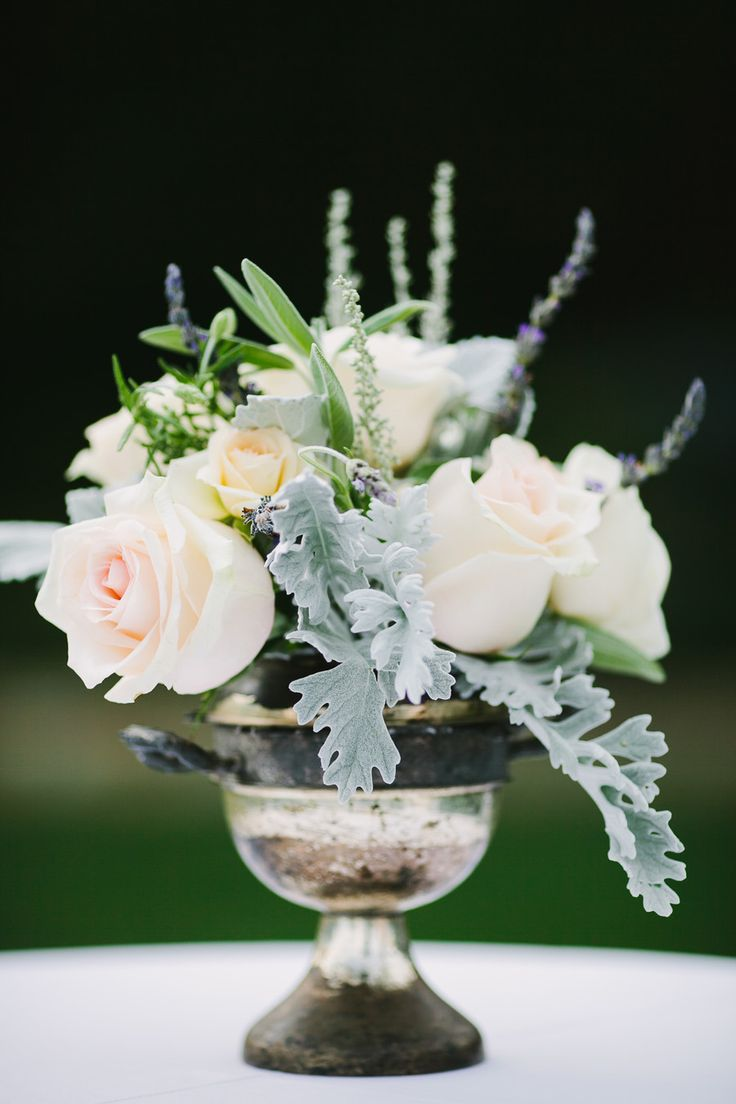 Sweet and simple centerpiece. Photography: Lisa Rigby Photography - lisarigbyphotography.com, Floral Design: Cody Floral Design - codyfloral.com  Read More: http://www.stylemepretty.com/california-weddings/2014/05/28/romantic-san-ysidro-ranch-wedding/