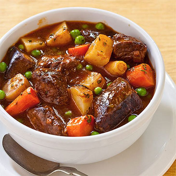 Beef Stew – Pressure Cooker Recipe Main Dishes with beef stew meat, olive oil, flour, salt, pepper, water, paprika, dried rosemary, thyme, bay leaf, onions, garlic cloves, carrots, large potatoes, peas
