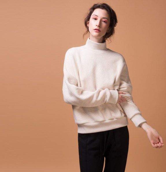 Odeyalo-beaufort-sweatshirt-3  This oversized sweatshirt is made with a 100% cotton loopback fabric that is soft, fresh and breathable.  Its mock neck, cuffs and bottom band are made of a stretch cotton rib that will hug you softly.  This top is definitely our favorite transitional item for spring!    Model is 5'8″/173 cm and is wearing size XS/S  100% cotton body/ 95% cotton, 5% spandex trims  Designed and made in Montreal.