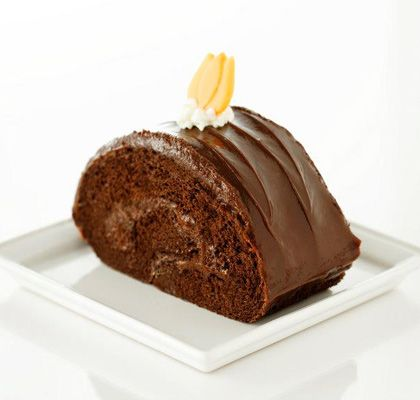 Enjoy this rolled sponge cake with chocolate filling and icing.