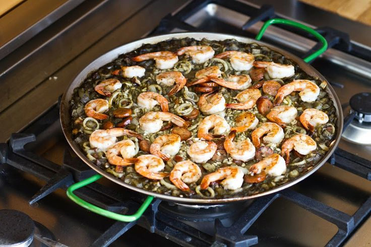 Spain (Paella Negra) Black Paella with Squid and Shrimp PLEASE ASS MANILA CLAMS AND MUSSELS